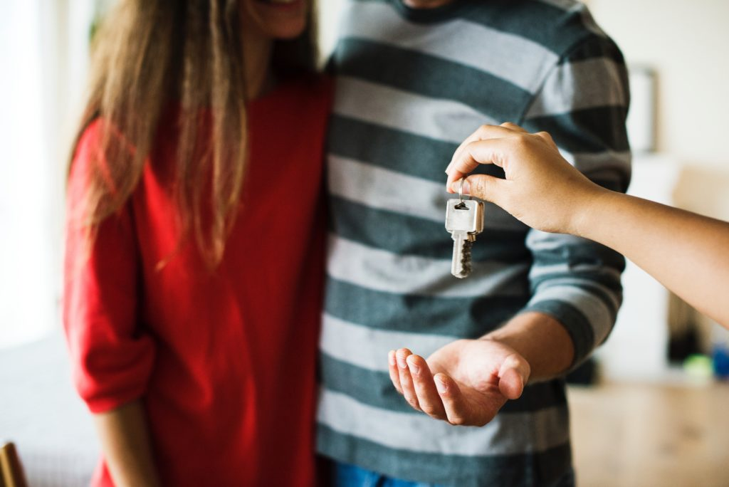 A Young Couple Getting the Key to Their New Laguna Beach Home